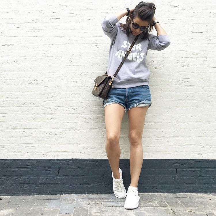 Streetstyle spring summer look 2016 Levi's cut off's Julian sweater by Rika, Louis Vuitton Pochette Metis, Adidas Tubular special women's edition white
